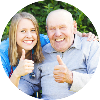 caregiver and old man doing thumbs up