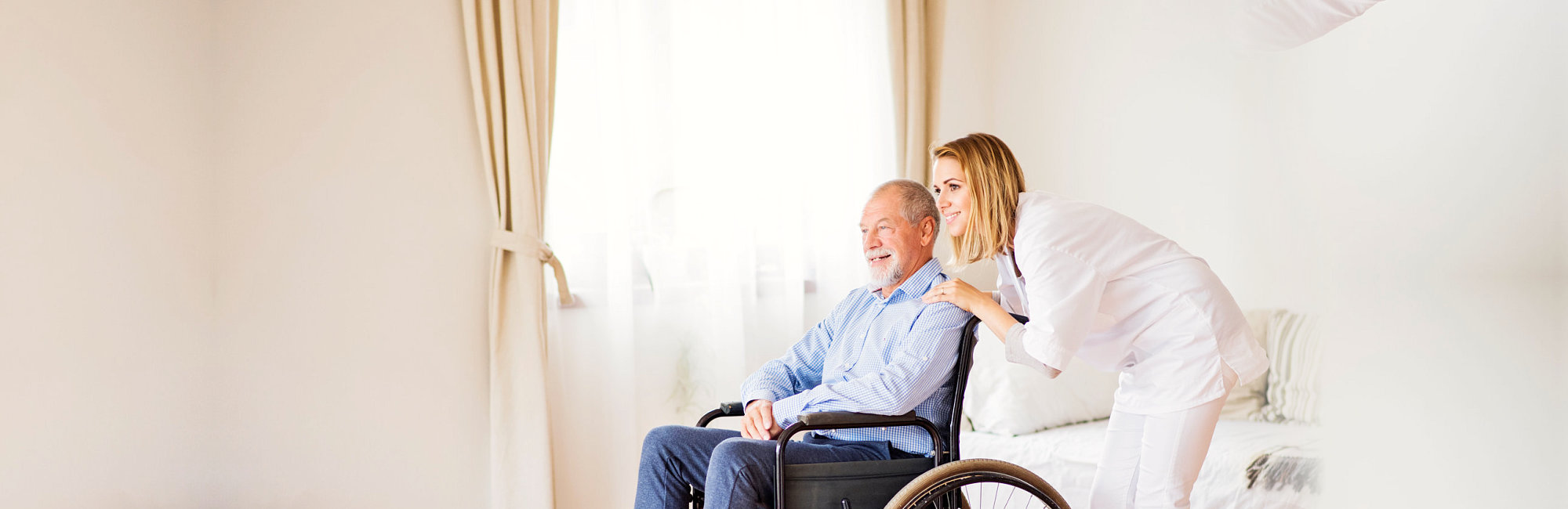 smiling caregiver and old man