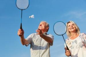 happy couple playing badminton